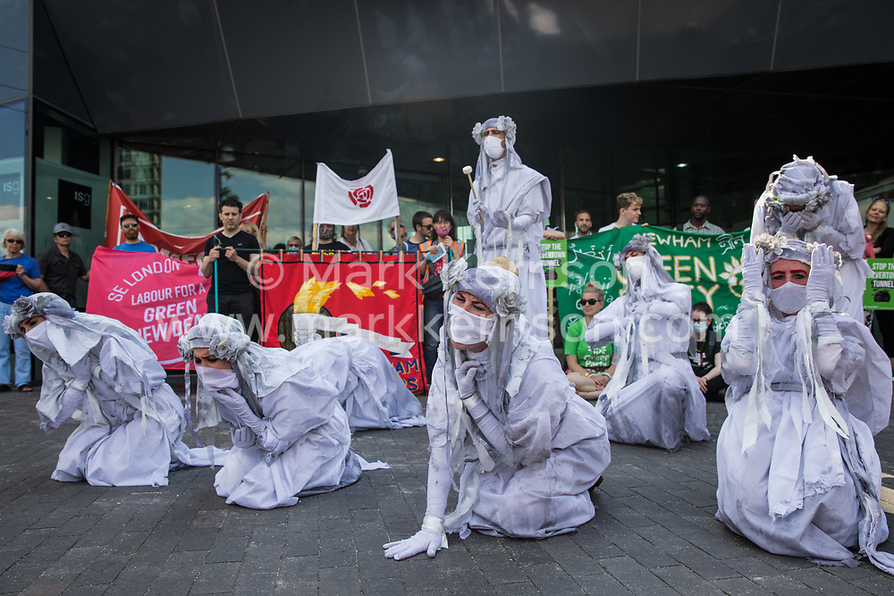 London, UK. 5th June, 2021. Extinction Rebellion banshees perform in front of environmental activists and local residents protesting against the construction of the Silvertown Tunnel. Campaigners opposed to the controversial new £2bn road link across the River Thames from the Tidal Basin Roundabout in Silvertown to Greenwich Peninsula argue that it is incompatible with the UK's climate change commitments because it will attract more traffic and so also increased congestion and air pollution to the most polluted borough of London.