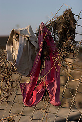 30 Sept, 2005.  New Orleans, Louisiana. Lower 9th ward. Hurricane Katrina aftermath.<br />  The remnants of the lives of ordinary folks, now covered in mud as the flood waters recede. Underwear clings to a fence along with flood debris.<br /> Photo; ©Charlie Varley/varleypix.com