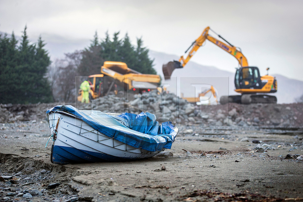© Licensed to London News Pictures. 18/03/2016. Cumbria UK. File picture shows the road to the steamer pier at Ullswater damaged by storms last December. The Department for Transport has pledged an additional £82.6m today to fund essential repairs to infrastructure in Cumbria damaged by Storms Desmond & Eva last December. Photo credit: Andrew McCaren/LNP