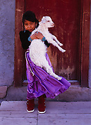Five-year-old Leatrice Mannie holding a young goat, Navajo Reservation near Ganado, Arizona.  Please Note: A small extra licensing fee needs to be paid to the Mannie Family for usage of this photo. Contact Fred Hirschmann for more information. Thanks.
