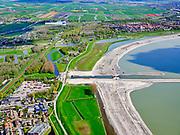 Nederland, Noord-Holland, gemeente Koggenland; 07-05-2021; Hoogheemraadschap Hollands Noorderkwartier, omgeving De Hulk met linksonder Scharwoude met dijkmagazijn aan de IJsselmeerdijk. In het kader van de dijkverbetering wordt er een oeverdijk aangelegd, de nieuwe halfhoge dijk heeft een buitentalud wat voor de bestaande dijk aangebracht wordt. Ter hoogte van gemaal Westerkogge is reeds een uitwateringskanaal zichtbaar. <br /> Hollands Noorderkwartier water board, area De Hulk, Scharwoude at the bottom left with a dike warehouse on the IJsselmeerdijk. As part of the dyke improvement, an embankment dyke is being constructed, the new half-height dyke has an outer slope which will be installed in front of the existing dyke. A discharge channel is already visible near the Westerkogge pumping station.<br /> <br /> luchtfoto (toeslag op standard tarieven);<br /> aerial photo (additional fee required)<br /> copyright © 2021 foto/photo Siebe Swart