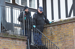 © Licensed to London News Pictures. 22/12/2018. London UK: Police search teams at the scene of a fatal stabbing in Tottenham high road. A male in his twenties was found in Albert Place near the high road with stab wounds and rushed to an east London hospital where he died at around 2.15 this morning , Photo credit: Steve Poston/LNP
