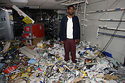 After the riots of London and other UK cities, Sri Lankan-born Sivaharan (Siva) Kandiah expresses shock in his looted shop 'Clarence Convenience Store' in Clarence Road, Hackney.