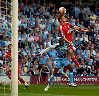 Photo: Jed Wee/Sportsbeat Images.<br /> Manchester City v Liverpool. The Barclays Premiership. 14/04/2007.<br /> <br /> Liverpool's John Arne Riise (R) rises to direct a header goalwards.
