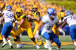 Oct 6, 2018; Morgantown, WV, USA; West Virginia Mountaineers quarterback Will Grier (7) looks to pass during the first quarter against the Kansas Jayhawks at Mountaineer Field at Milan Puskar Stadium. Mandatory Credit: Ben Queen-USA TODAY Sports