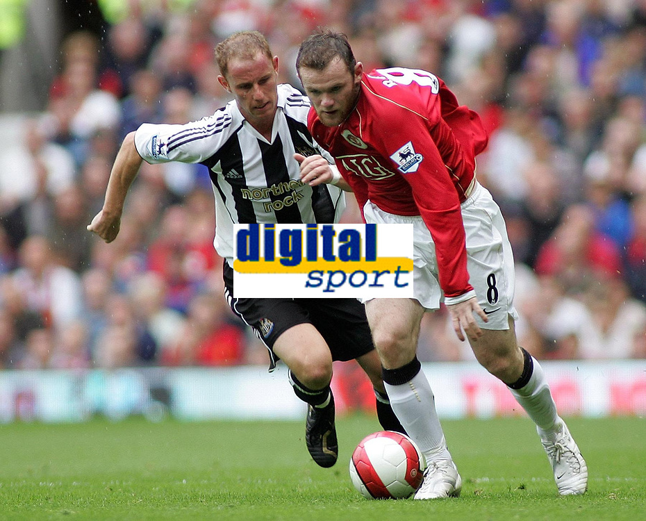 Photo: Paul Thomas.<br /> Manchester United v Newcastle United. The Barclays Premiership. 01/10/2006.<br /> <br /> Nicky Butt (L) of Newcastle is beaten by Wayne Rooney.