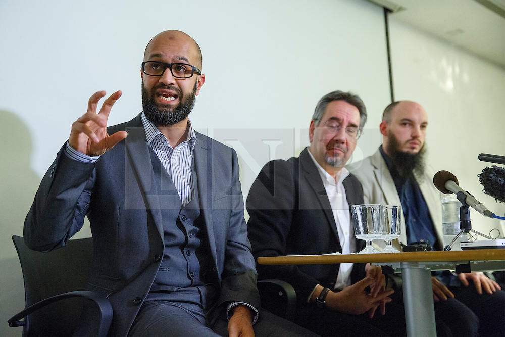 © Licensed to London News Pictures. 26/02/2015. LONDON, UK. Asim Qureshi (L) and Cerie Bullivant (R) from CAGE human rights organisation talk to media about British man Mohammed Emwazi, who believed to be Islamic State militant known as 'Jihadi John' during a press conference in central London on Thursday, 26 February 2015. Photo credit : Tolga Akmen/LNP