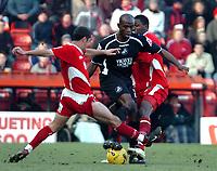 Photo: Ed Godden.<br />Bristol City v Swansea. Coca Cola League 1. 28/01/2006.<br />Swansea's Adrian Forbes (C) surges through the Swindon defence.