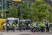 British mounted police officers secure the area of the United States Embassy in East London, on Saturday, July 10, 2020 - as people holding placards and most of them wearing surgical face masks to curb the spread of coronavirus pandemic, organised by Black Lives Matter are holding the seventh weekend of protests in front of the US Embassy in East London. Anger against systemic levels of institutional racism have raged through the city, and worldwide; sparked by the death of George Floyd who died on May 25 after he was restrained by Minneapolis police in the United States. (VXP Photo/ Vudi Xhymshiti)