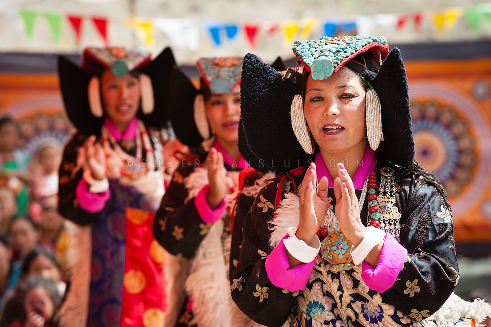 Women in traditional Ladakhi dress performing at a temple opening festival in Arzu, Ladakh, India. Photo © Robert van Sluis