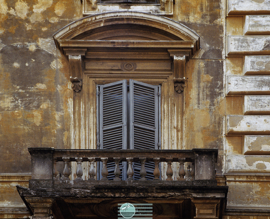 """Old world architecture captured in doors and windows from Mexico and Europe.  Walk back in time through worn textures and colors both muted and vibrant. Rome (/ˈroʊm/; Italian: Roma pronounced [ˈroːma] ( listen); Latin: Rōma) is a city and special comune (named """"Roma Capitale"""") in Italy. Rome is the capital of Italy and also of the homonymous province and of the region of Lazio. With 2.8 million residents in 1,285.3 km2 (496.3 sq mi), it is also the country's largest and most populated comune and fifth-most populous city in the European Union by population within city limits. Between 3.2 and 3.8 million people live in the urban area. and 4,194,068 in Rome metropolitan area.[3][4][5][6][7][8][9] The city is located in the central-western portion of the Italian Peninsula, on the Tiber within the Lazio region of Italy. Rome is referred to as """"The Eternal City"""", a notion expressed by ancient Roman poets and writers."""