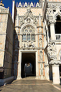 Gothic style Ceremonial entrance, the Porta della Carta ( 1438-1442), on the eastern facade of The Doge's Palace with statues of sculptural portrait of the Doge Francesco Foscari kneeling before the St. Mark's Lion.  , Palazzo Ducale, Venice Italy .<br /> <br /> Visit our ITALY HISTORIC PLACES PHOTO COLLECTION for more   photos of Italy to download or buy as prints https://funkystock.photoshelter.com/gallery-collection/2b-Pictures-Images-of-Italy-Photos-of-Italian-Historic-Landmark-Sites/C0000qxA2zGFjd_k<br /> <br /> <br /> Visit our MEDIEVAL PHOTO COLLECTIONS for more   photos  to download or buy as prints https://funkystock.photoshelter.com/gallery-collection/Medieval-Middle-Ages-Historic-Places-Arcaeological-Sites-Pictures-Images-of/C0000B5ZA54_WD0s