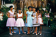 Sixth form girls dressed in pretty dresses for Bazaar Day, Bishop Anstey high school for girls, Port of Spain, Trinidad 1962