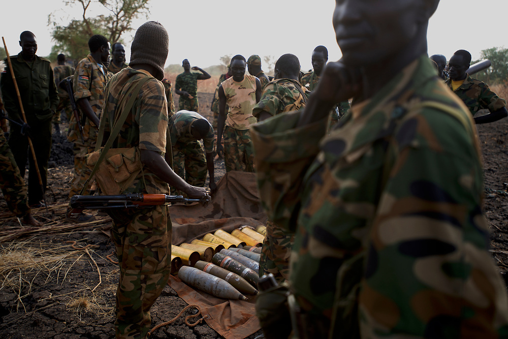 A group of SPLA soldiers prepares mortar shells at the last defensive line, outside the village of Panakuach, north of Bentiu, during combats between South Sudan military and the neighbouring Sudan over the control of oil fields in a disputed border area.