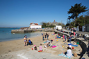 Families enjoy the spring sunshine at Sandycove Beach on 08th April 2017 in County Dublin, Republic of Ireland. Sandycove is a popular seaside resort in County Dublin