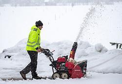 THEMENBILD - Ein Mann bedient eine Schneefräse aufgenommen am Dienstag, 12. November 2019, in Strassen in Osttirol. Heute schneit es in Österreich verbreitet bis in tiefe Lagen. Ein Teil des Schneefalls konzentriert sich dabei auf Osttirol. Hier kommen laut ZAMG bis Mittwochabend selbst in Tallagen 20 bis 50 Zentimeter Neuschnee zusammen. Vereinzelt sind auch bis zu 75 Zentimeter möglich, wie im Tiroler Gailtal // A man operates a snowblower taken on Tuesday, November 12, 2019, in Strassen in Osttirol. Today it is snowing in Austria to low altitudes. Part of the snowfall is concentrated on East Tyrol. According to ZAMG, 20 to 50 centimeters of fresh snow come together here even in valleys on Wednesday evening. Occasionally, up to 75 centimeters are possible, as in the Tyrolean Gail Valley. EXPA Pictures © 2019, PhotoCredit: EXPA/ Johann Groder