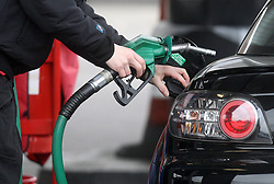 File photo dated 22/02/13 of a person using a petrol pump. RAC Fuel Watch data shows there was a 3.5p per litre fall in wholesale prices yet petrol started and finished the month at 130.6p per litre.