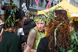 London, UK. 18th April 2019. Climate change activists from Extinction Rebellion at Oxford Circus take part in the fourth day of the International Rebellion to call on the British government to take urgent action to combat climate change.