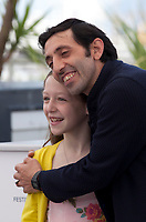 Actor Marcello Fonte and actress Alida Baldari Calabria  at the Dogman film photo call at the 71st Cannes Film Festival, Thursday 17th May 2018, Cannes, France. Photo credit: Doreen Kennedy