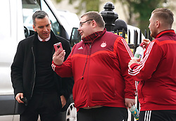 Aberdeen manager Stephen Glass (left) with fans as he arrives to the ground ahead of the cinch Premiership match at Pittodrie Stadium, Aberdeen. Picture date: Sunday October 3, 2021.