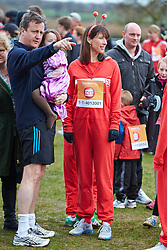 © Licensed to London News Pictures.  23/03/2014. OXFORD, UK. Prime minister DAVID CAMERON (left) and wife SAMANTHA CAMERON (centre) and family at the start of the Oxford Sport Relief Mile. Photo credit: Cliff Hide/LNP