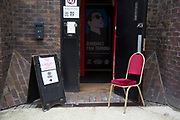 Chair in a scene outside a stage door where auditions are being held for The Landlady play. West End, London, UK.