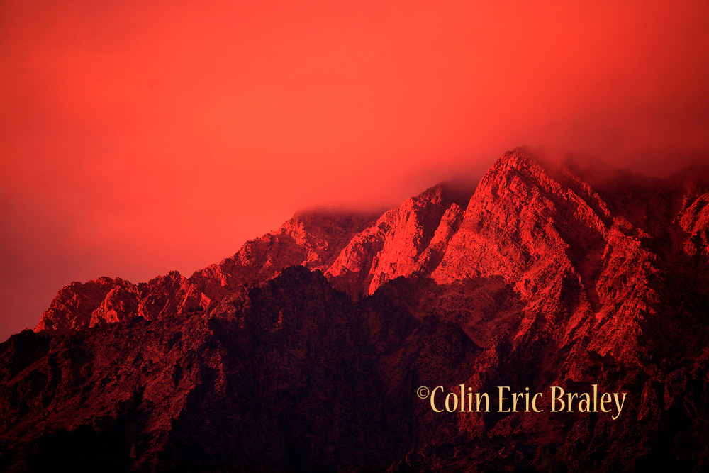 A sunset turns the Wasatch mountains into an unnatural red hue near Ben Lomond Peak in Utah. Colin Braley/Wild West Stock