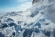 Ice built up on shore in Baikalskoe Village on Lake Baikal. Siberia, Russia