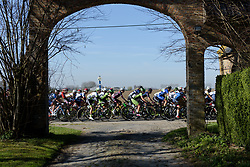 Peloton speed by at Women's Gent Wevelgem 2017. A 145 km road race on March 26th 2017, from Boezinge to Wevelgem, Belgium. (Photo by Sean Robinson/Velofocus)