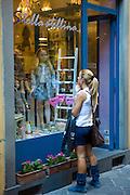 Shopper in Chiasso Barletti by Via Fillungo, Lucca, Italy