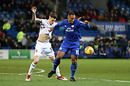 Kenneth Zohore of Cardiff city ® holds on to the shirt of Reece Burke of Bolton Wanderers. EFL Skybet championship match, Cardiff city v Bolton Wanderers at the Cardiff city Stadium in Cardiff, South Wales on Tuesday 13th February 2018.<br /> pic by Andrew Orchard, Andrew Orchard sports photography.