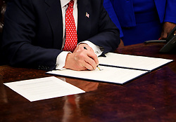 U.S. President Donald Trump speaks before signing the HBCU Executive Order to support Black Colleges and Universities in the Oval Office of the White House, February 28, 2017. (pool / Aude Guerrucci)
