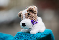 © Licensed to London News Pictures. 27/04/2016. Thirsk UK. Picture shows  a knitted dog on a bollard in Thirsk that has been Yarn Bombed. Under the cover of Darkness 300 Yarn bombing street artist's have covered the Town centre of Thirsk, the group has covered bollards, flower pots, the bus stop, tree's, benches, even the local police station. The knitted creations took over 750 balls of wool & have been placed along the route of the Tour De Yorkshire which will pass through the town during it's final stage from Middlesborough to Scarborough on Sunday.  Photo credit: Andrew McCaren/LNP