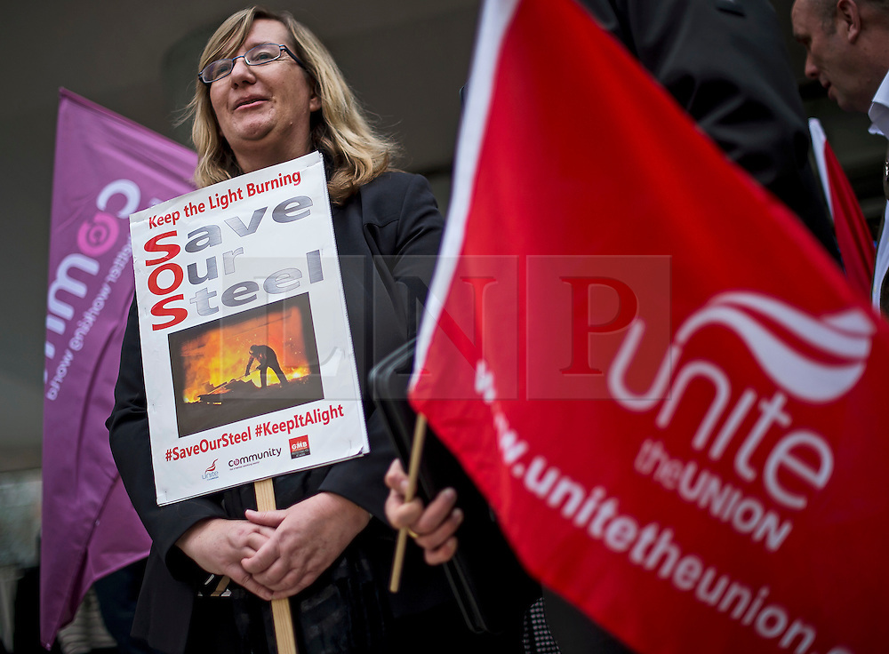 """© Licensed to London News Pictures. 04/04/2016. London, UK. A woman holds a banner reading """"Save Our Steel"""" as workers from TATA Steel arrive at Congress House in London where they are due to hold a meeting, organised by the Trade Union Congress (TUC), to discuss the future of Port Talbot TATA steel works. Photo credit: Ben Cawthra/LNP"""