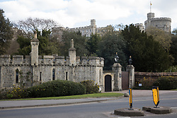 Windsor, UK. 16th April, 2021. Windsor Castle is pictured behind Datchet Road Lodge on the eve of the funeral of the Duke of Edinburgh. The funeral of Prince Philip, Queen Elizabeth II's husband, will take place at St George's Chapel in Windsor Castle at 15:00 BST on 17th April.