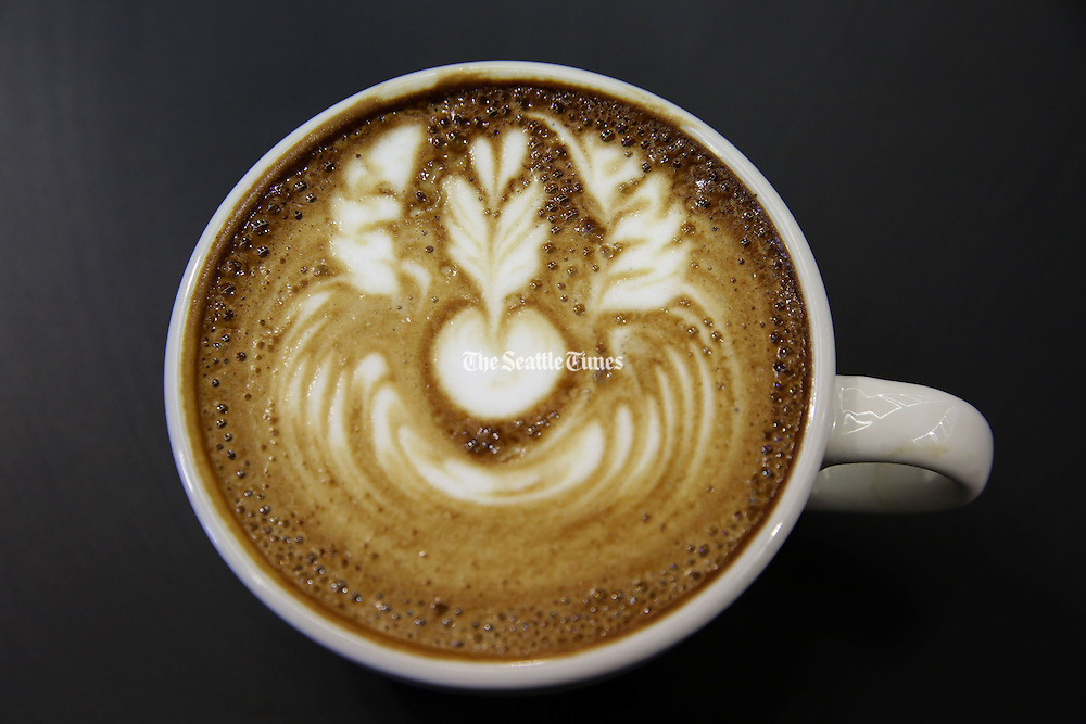 A free-poured latte sits on a counter after being created at the U.S. Latte Art Championship at the Washington State Convention Center Thursday, April 24, 2014.<br /> <br /> Erika Schultz / The Seattle Times