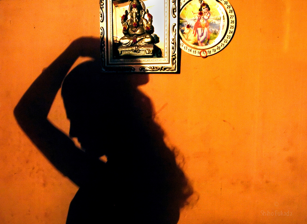 """A transgender prostitute prepares for work in Chennai, India. <br /> Transgender sex worker enters a hotel room with her client in Villupuram, India. As transgenders,""""hijras"""" in local terms, are acutely marginalized in Indian society, the major earning avenues for them are sex work, begging and performing at rituals."""
