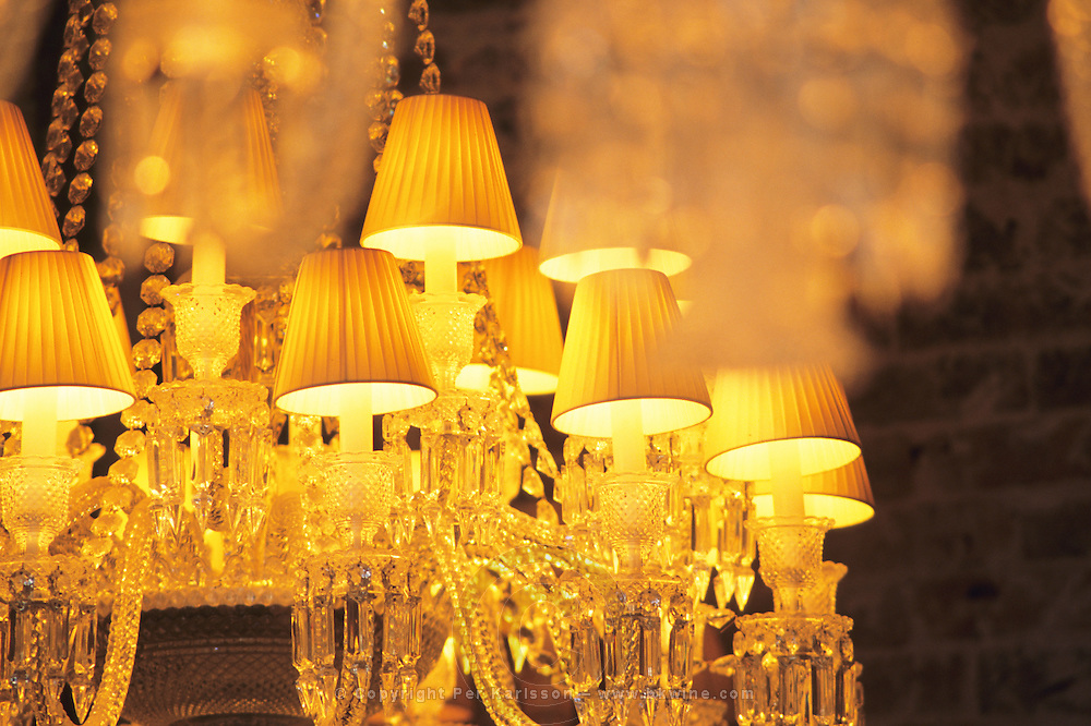 """One of the crystal chandeliers at The Baccarat Restaurant """"Le Cristal Room"""", in the old dining room. Crystal chandeliers and glasses. Designed by Philippe Starck."""
