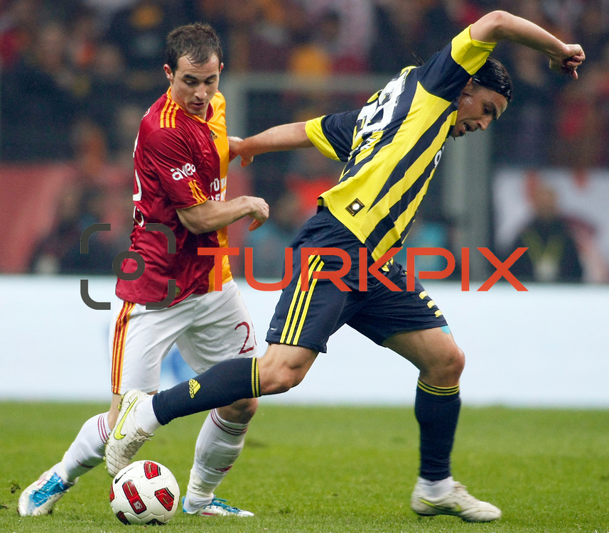 Galatasaray's Bogdan Sorin STANCU (L) and Fenerbahce's Mehmet TOPUZ (R) during their Turkish superleague soccer derby match Galatasaray between Fenerbahce at the Turk Telekom Arena in Istanbul Turkey on Friday, 18 March 2011. Photo by TURKPIX