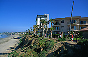 Beachside hotels on small cliff above sandy beach, San Diego, California, USA
