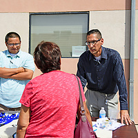 Christopher Laughlin, left, training coordinator for Tohatchi Area of Opportunity and Services (Taos, Inc.) and Kevin Dauphinais, HR manager for Taos, Inc. at a job fair hosted by New Mexico Workforce Connections, Thursday, August 30, 2018 in Gallup.