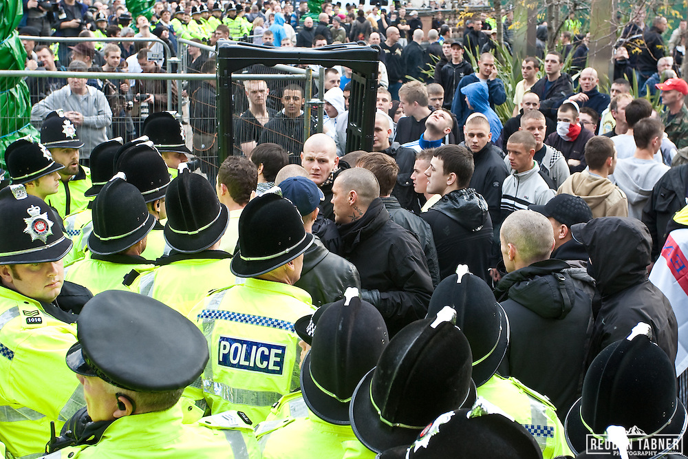 EDL members attempt to push their way out of City Square.