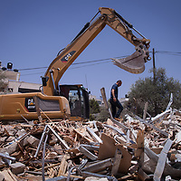 """Mohammed Sbeah's house in Beit Hanina, a Palestinian neighbourhood in East Jerusalem, was demolished on 4th July 2017. Mr Sbeah explained what happened: """"I was surprised that I saw a big bulldozer, with a lot of army and policemen and special forces, they came with the local governent. They started tearing my house down, without taking me to court, without me seeing a judge or anything. They just teared down the house"""". His family is now living in his mother-in-law's house. The local community has helped him clear the debris."""