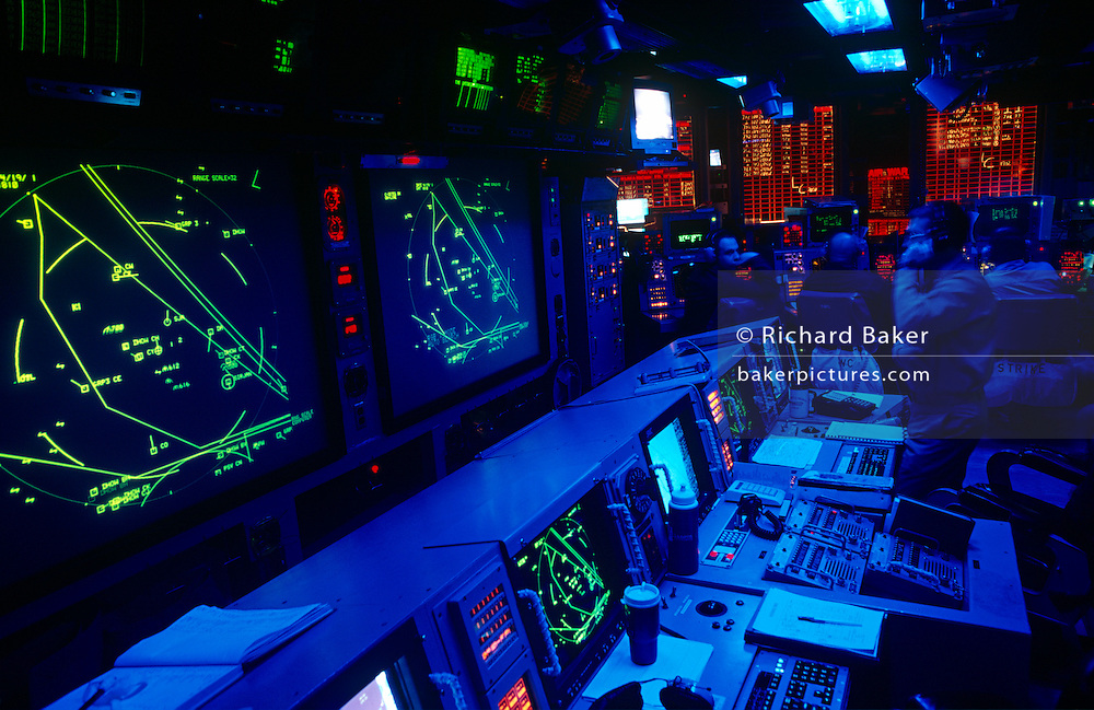 The below-deck highly-classified Conflict Direction Center or War Room on the aircraft carrier US Navy USS Harry S Truman. This top secret office is used for planning and executing sophisticated tactical electronic warfare that fighter jets and surveillance aircraft engage in from air operations mounted from the carrier. The Truman is the largest and newest of the US Navy's fleet of new generation carriers, a 97,000 ton floating city with a crew of 5,137, 650 are women. The Iraqi no-fly zones (NFZs) were proclaimed by the United States, United Kingdom and France after the Gulf War of 1991 to protect humanitarian operations in northern Iraq and Shiite Muslims in the south. Iraqi aircraft were forbidden from flying inside the zones. The policy was enforced by US, UK and French aircraft patrols until France withdrew in 1998.  .