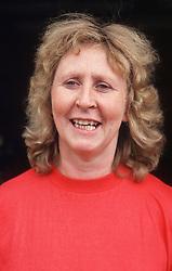 Portrait of woman wearing red jumper,