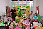 The Cui family of Weitaiwu village, Beijing Province, in their living room with a week's worth of food. From the book Hungry Planet: What the World Eats (Model Released)