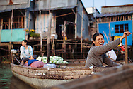 Women sell goods in the Cai Rang floating market in Can Tho, Vietnam.