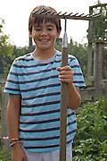 Edward, 12 in the vegetable garden at Hares Farm. CREDIT: Vanessa Berberian for The Wall Street Journal<br /> UKFARM-Hares Farm
