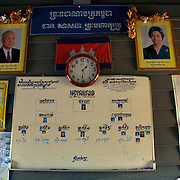 Pictures of government officials hanging on the wall of a primary school building in the floating village of Chong Kneas, just outside of Siem Reap, Cambodia.
