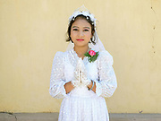 Portrait of Elizabeth an eleven year old ethnic Kayah girl at her first communion at Christ the King Cathedral in Loikaw, Kayah State, Myanmar on 20th November 2016. In the past most people residing in Kayah State were traditional spirit worshippers, but significant numbers have converted to Christianity, especially Baptist or Catholic